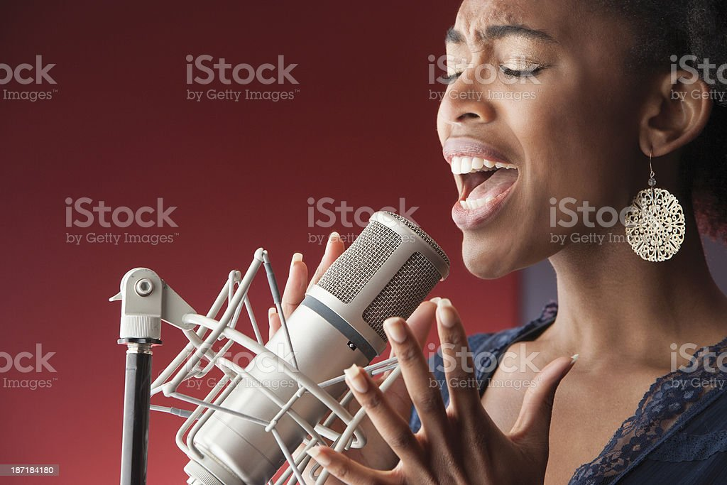 Female Singer Recording Vocals stock photo