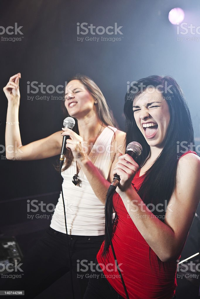Female singers performing stock photo