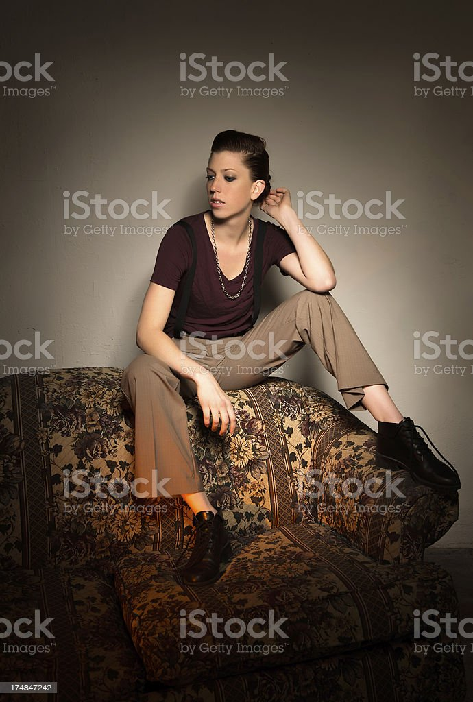 Female sitting on couch royalty-free stock photo