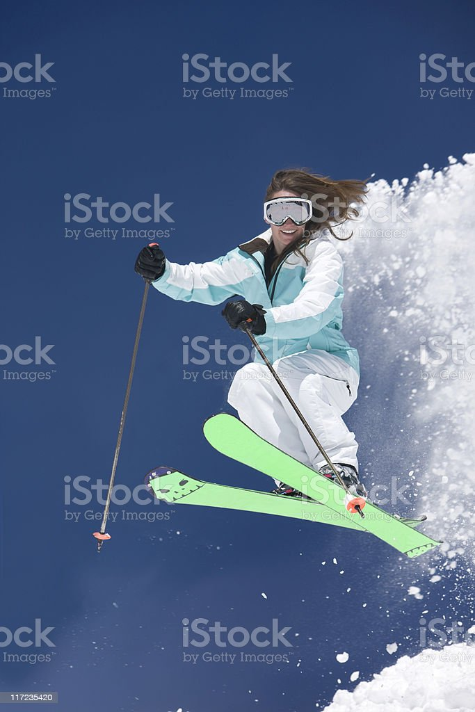 Female Skier Against A Bright Blue Sky royalty-free stock photo