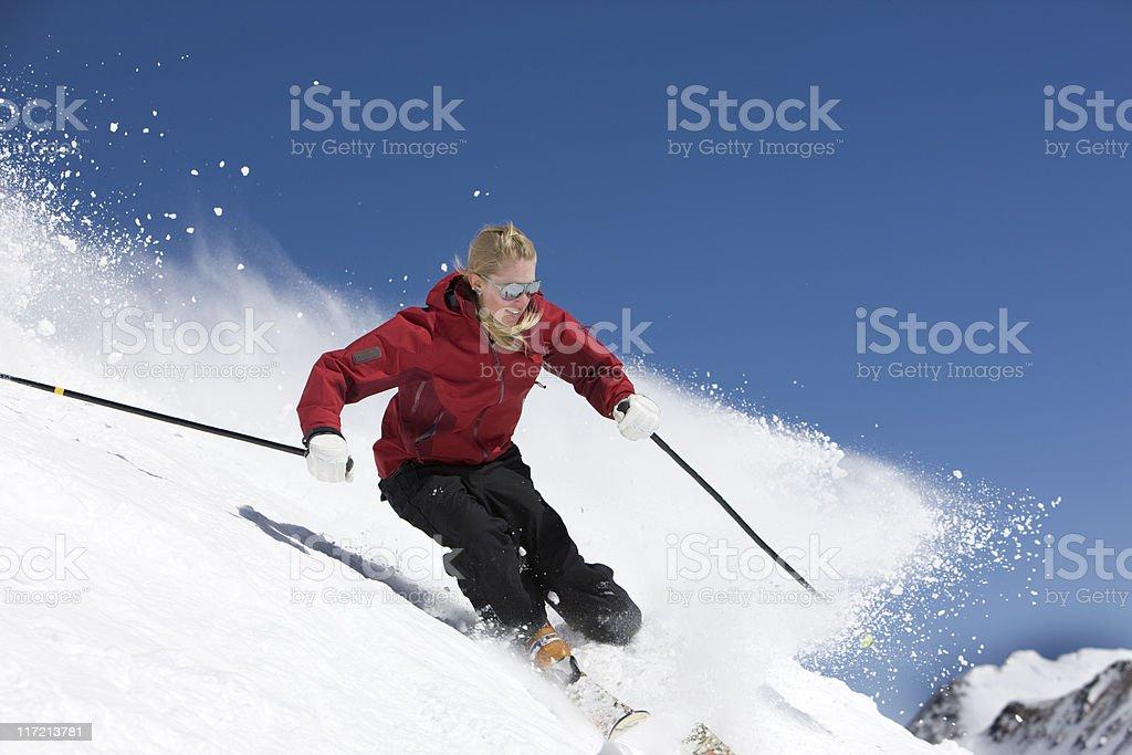 Female Skier Against Blue Sky royalty-free stock photo