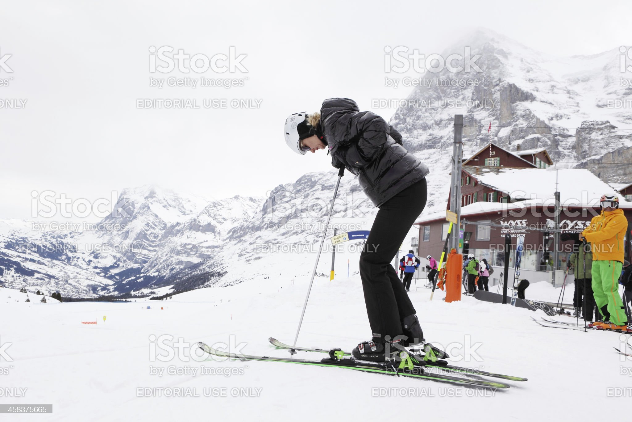 Female skier getting ready in Alps royalty-free stock photo