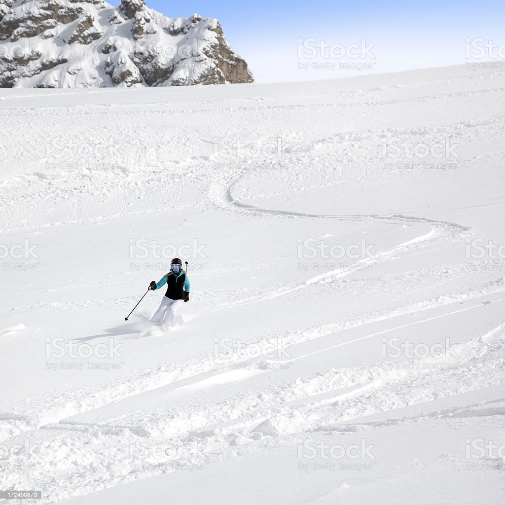 Female Skier in powder snow royalty-free stock photo