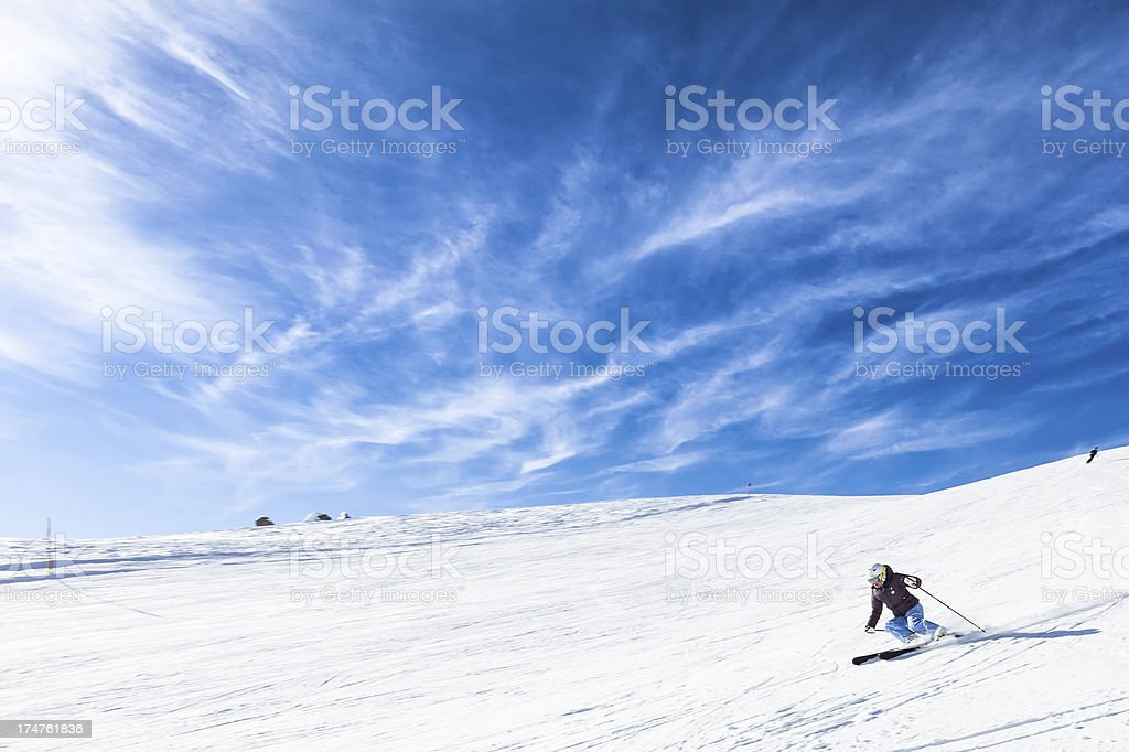 Female Skier in the Alps stock photo