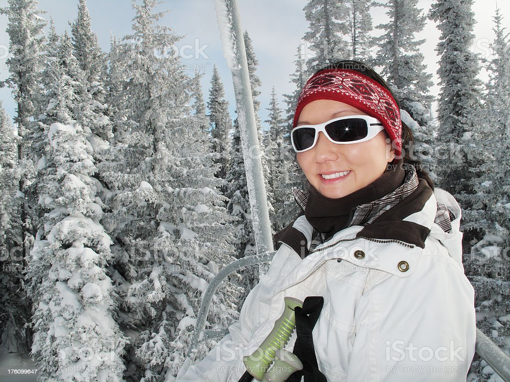 Female skier on chairlift royalty-free stock photo