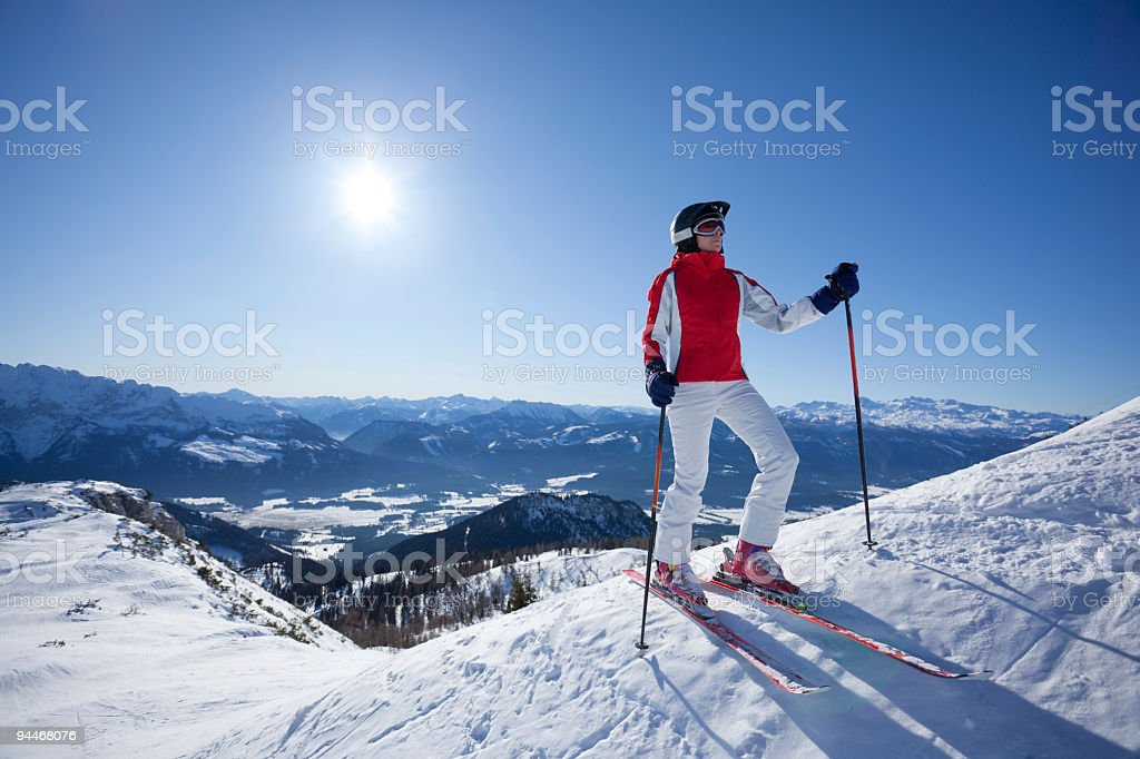 female skier on snowy hill at sunshine royalty-free stock photo