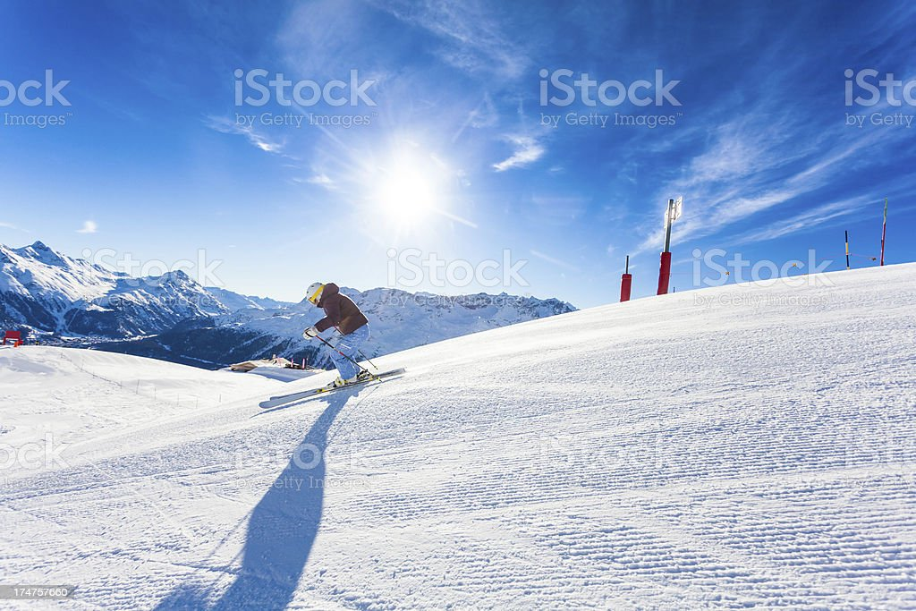Female Skier on the Alps and Sun stock photo