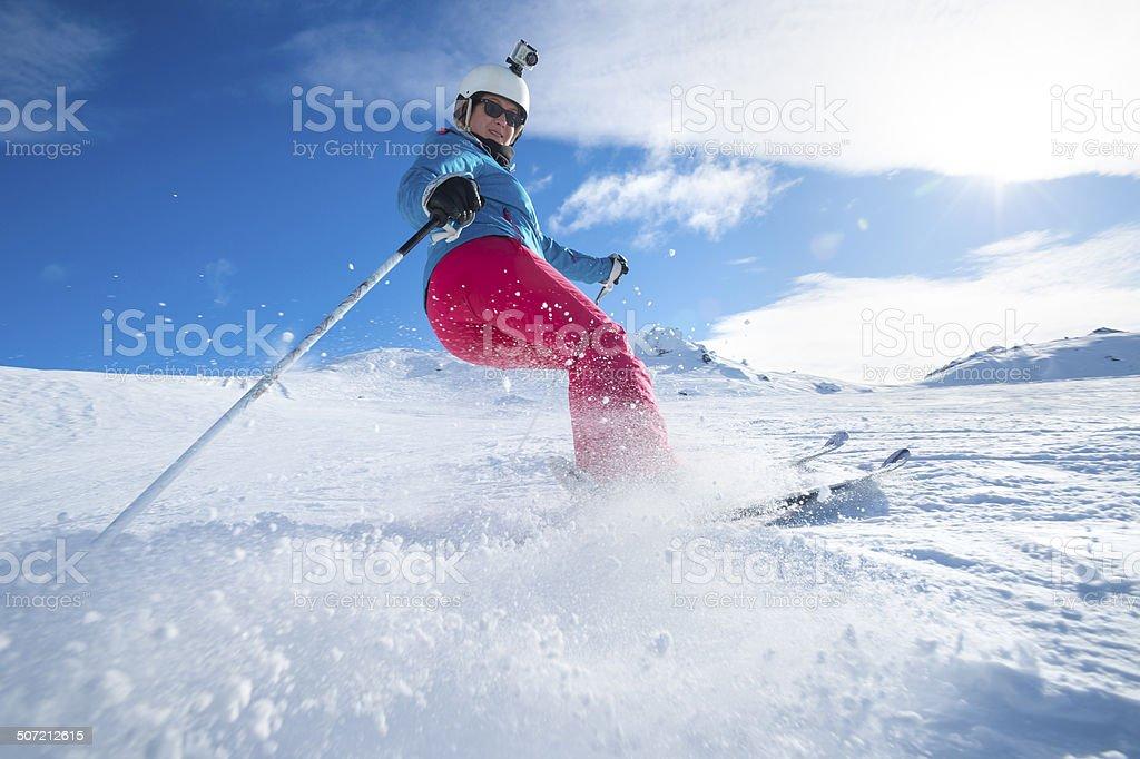 Female Skier turning stock photo