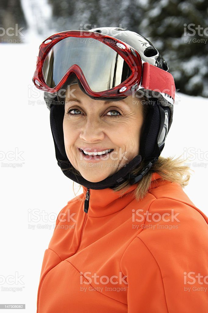 Female Skier with Snowball royalty-free stock photo