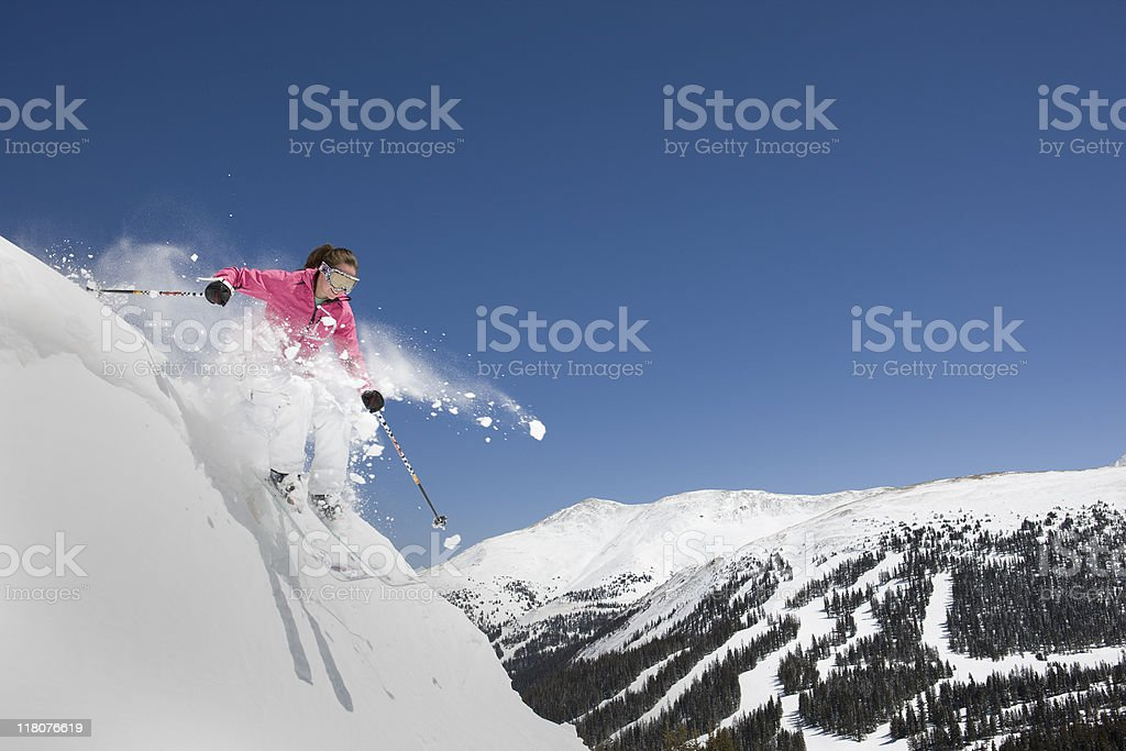 Female Skiing Downhill on Steep Slope royalty-free stock photo