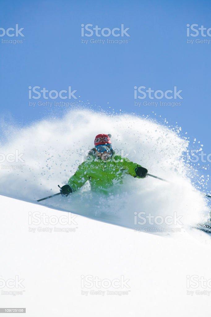 Female skiing in fresh powder snow royalty-free stock photo
