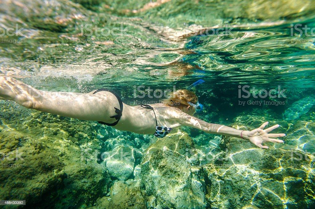 Female snorkeling stock photo