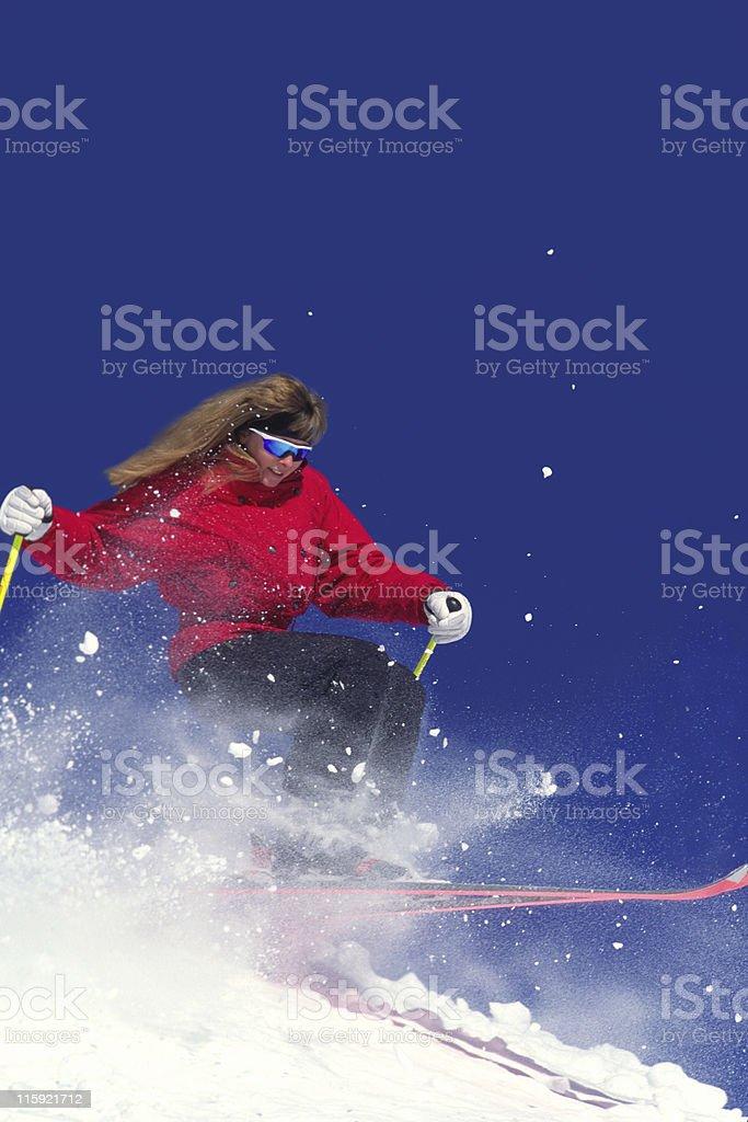 Female Snow Skier Against Blue Sky stock photo
