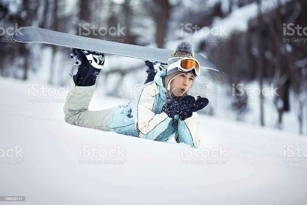 Female snowboarder blowing snow royalty-free stock photo