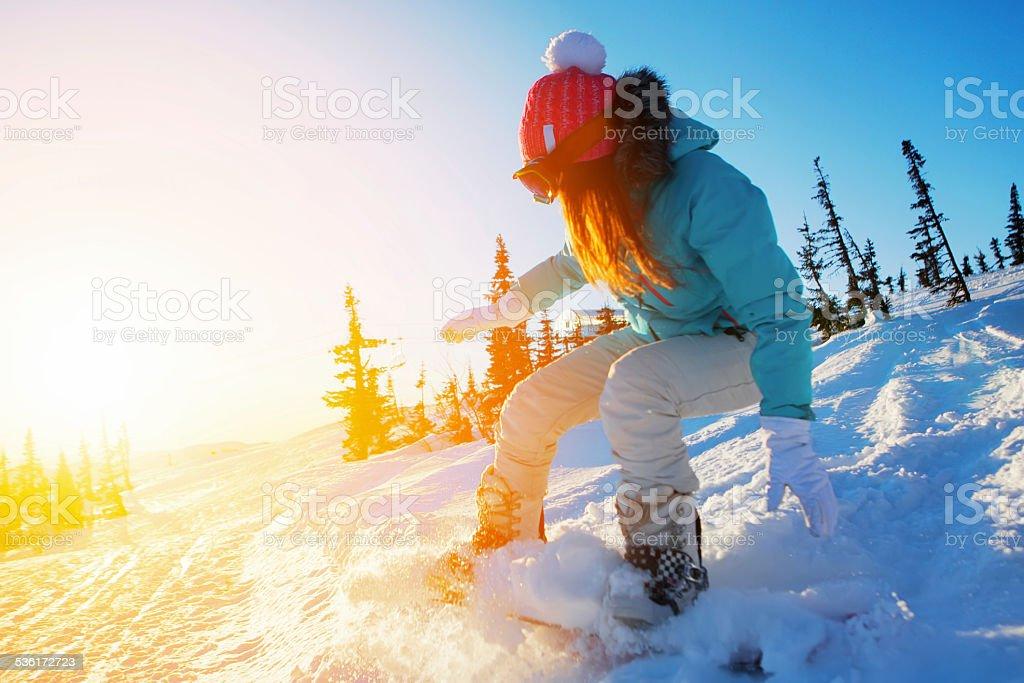 female snowboarder stock photo