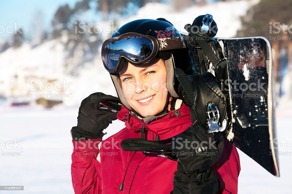 Female snowboarder smiling at the camera stock photo