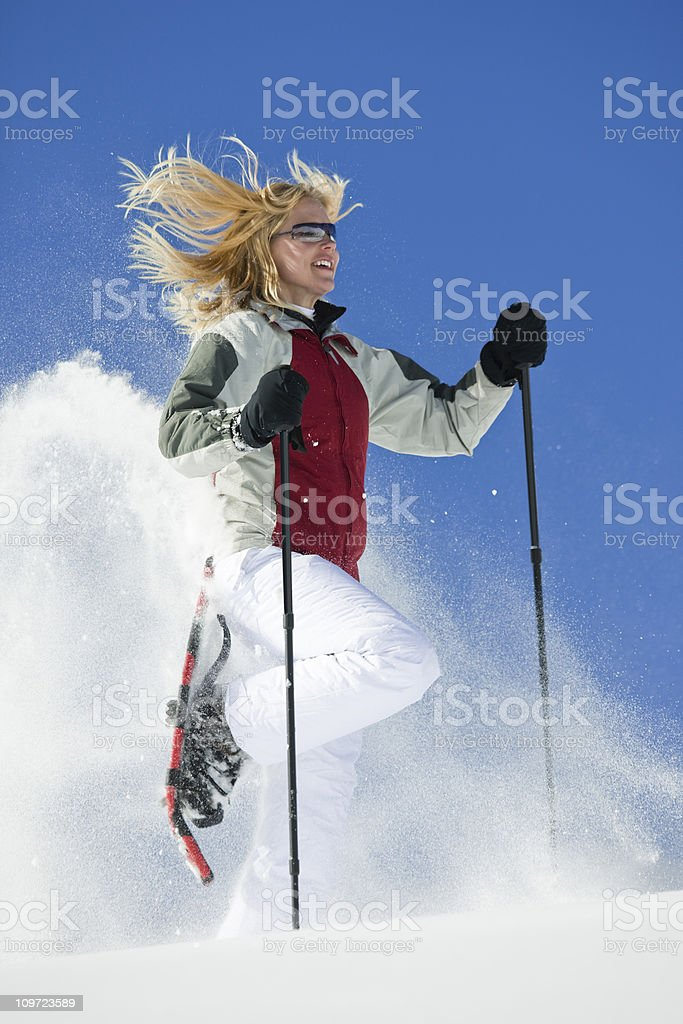 Female Snowshoeing In Powder Snow royalty-free stock photo