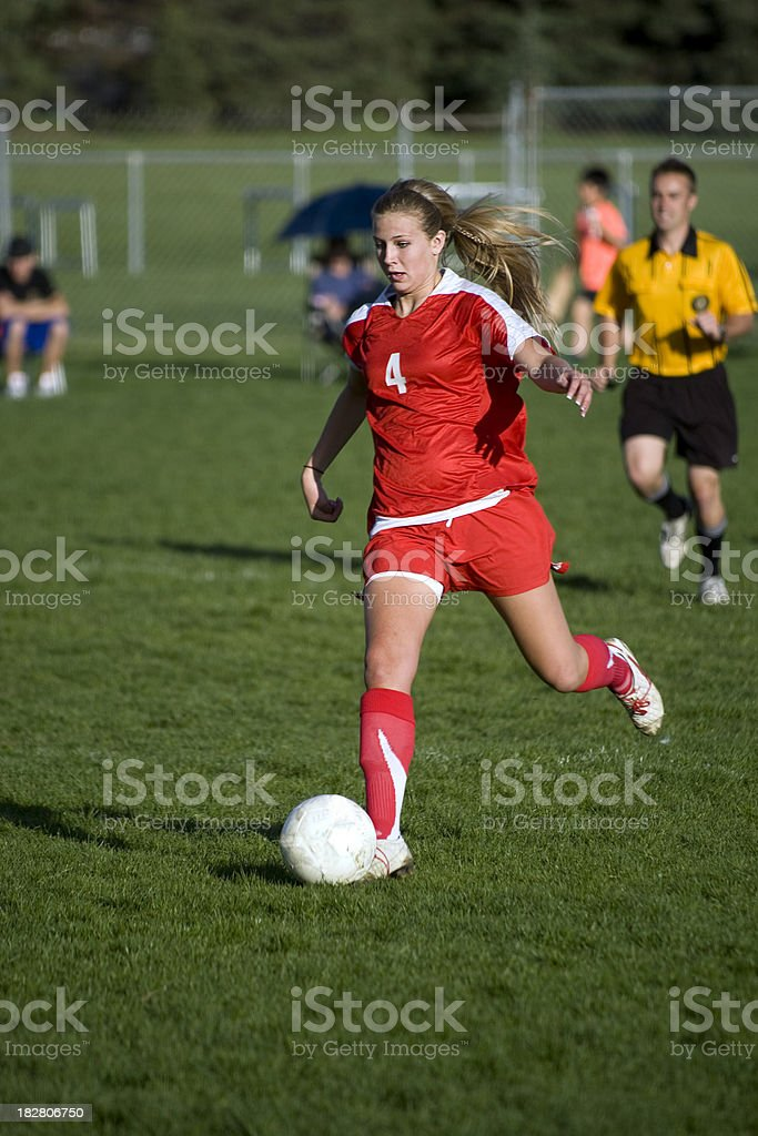 Female Soccer Player and Referee royalty-free stock photo