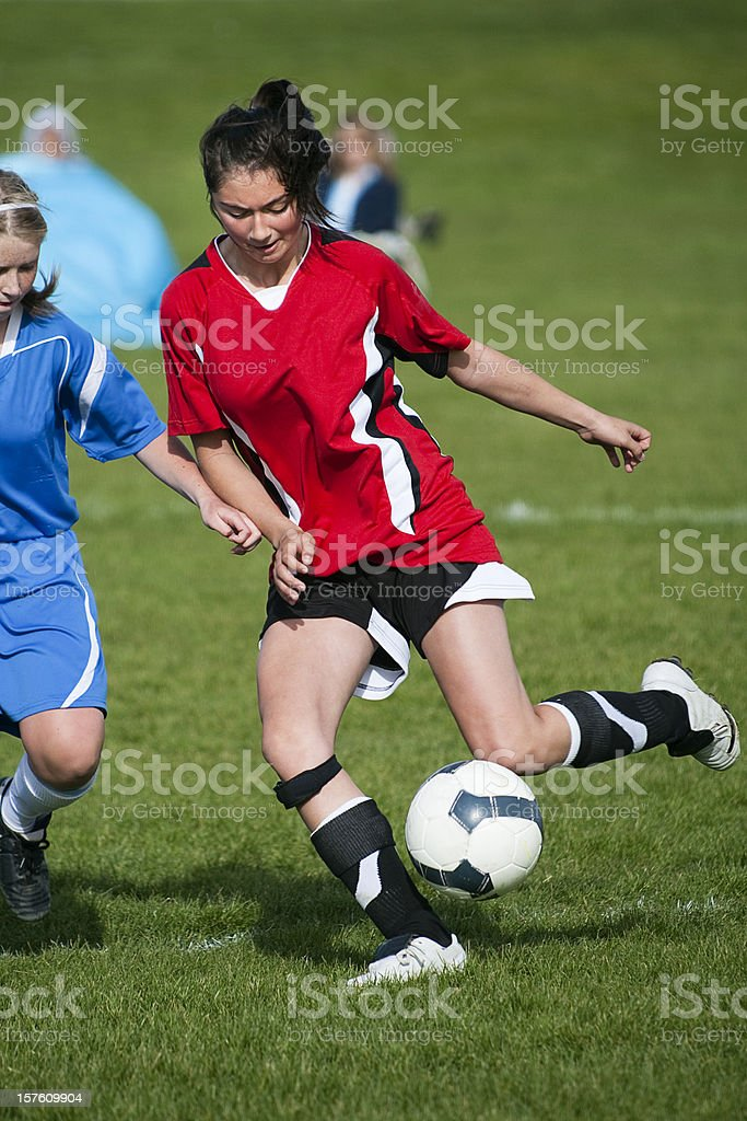 Female Soccer Player Controls Bouncing Ball royalty-free stock photo