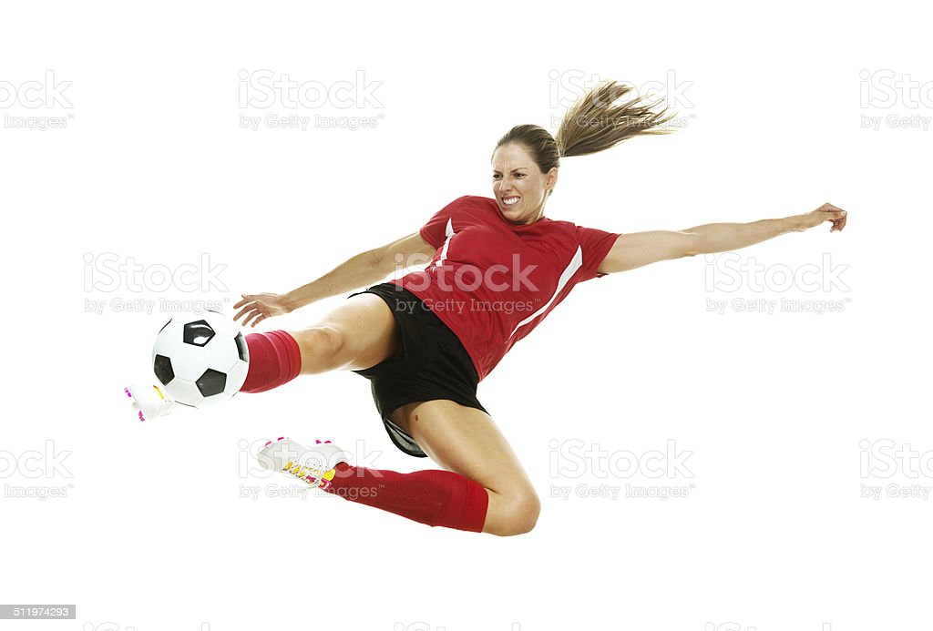 Female soccer player in action stock photo