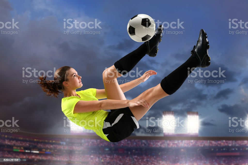 Female Soccer Player Performing Bicycle Kick stock photo