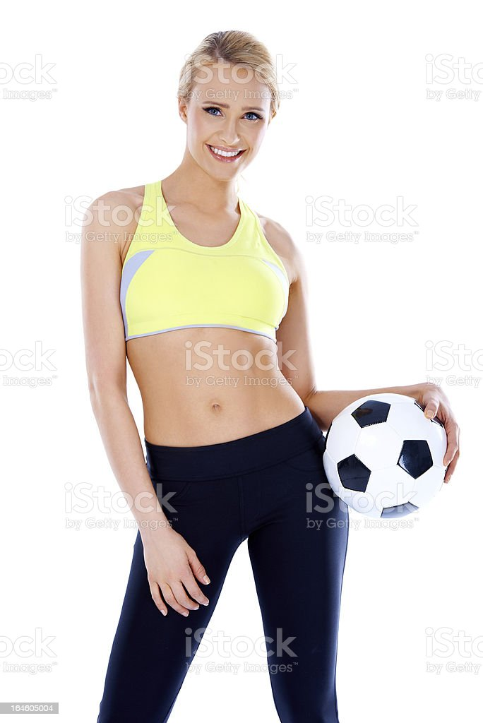Female soccer player posing with ball royalty-free stock photo