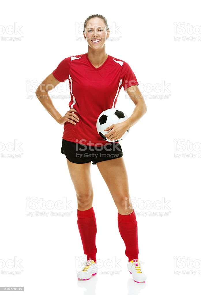 Female soccer player posing with ball stock photo