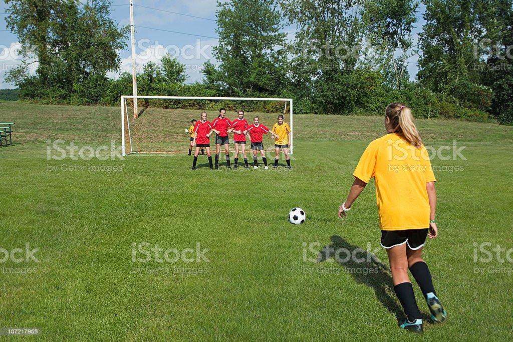 Female soccer player taking free kick stock photo