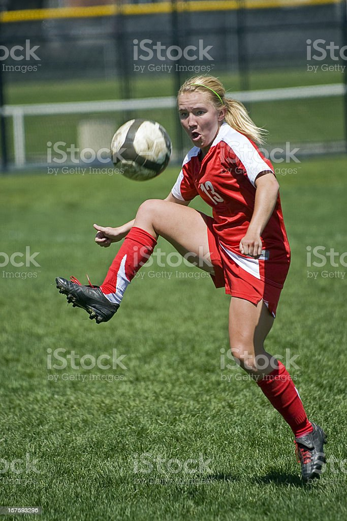 Female Soccer Player Trapping Airborn Ball royalty-free stock photo