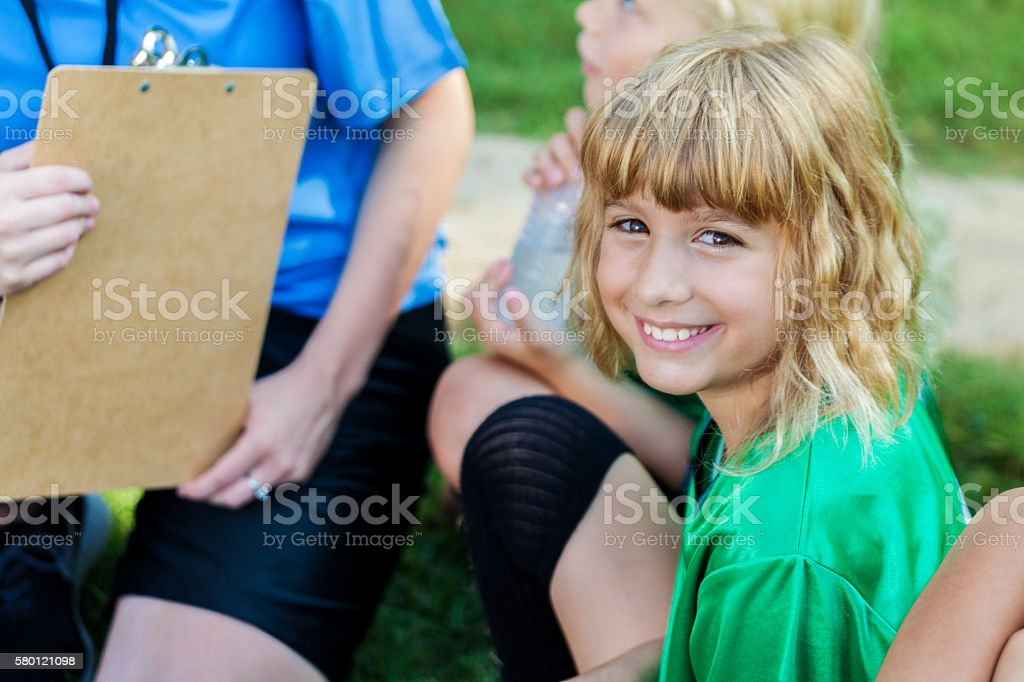 Female soccer player with team during time out stock photo