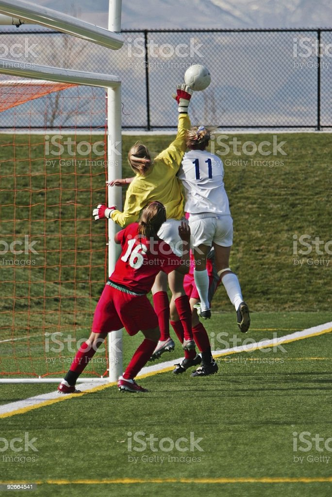 Female Soccer Players Compete for Airborne Ball at Far Post royalty-free stock photo