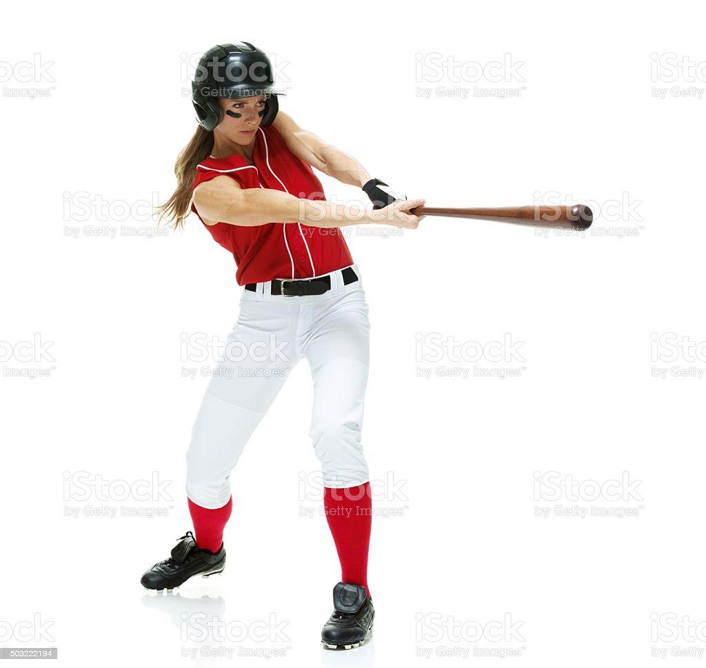 Female softball player batting stock photo