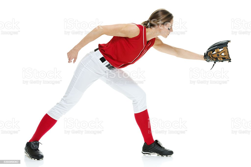 Female softball player fielding stock photo