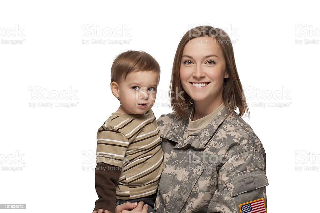 Female soldier and her child smiling stock photo