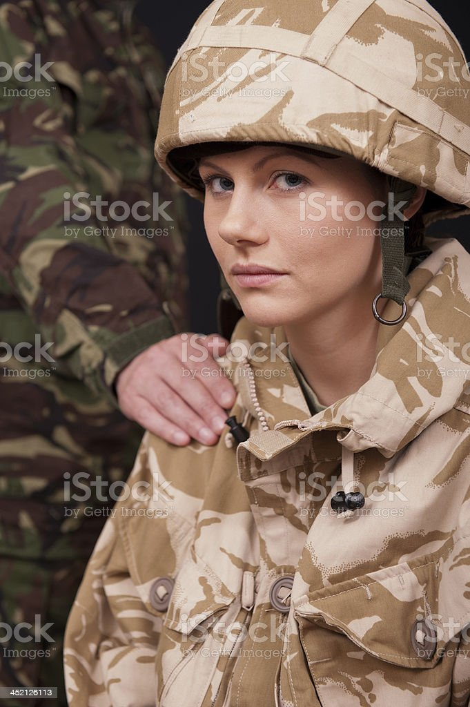 Female Soldier Being Comforted stock photo