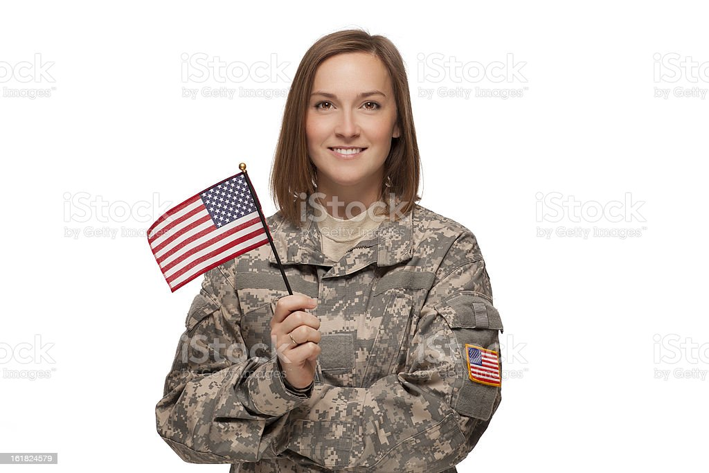 Female soldier holding an American Flag royalty-free stock photo