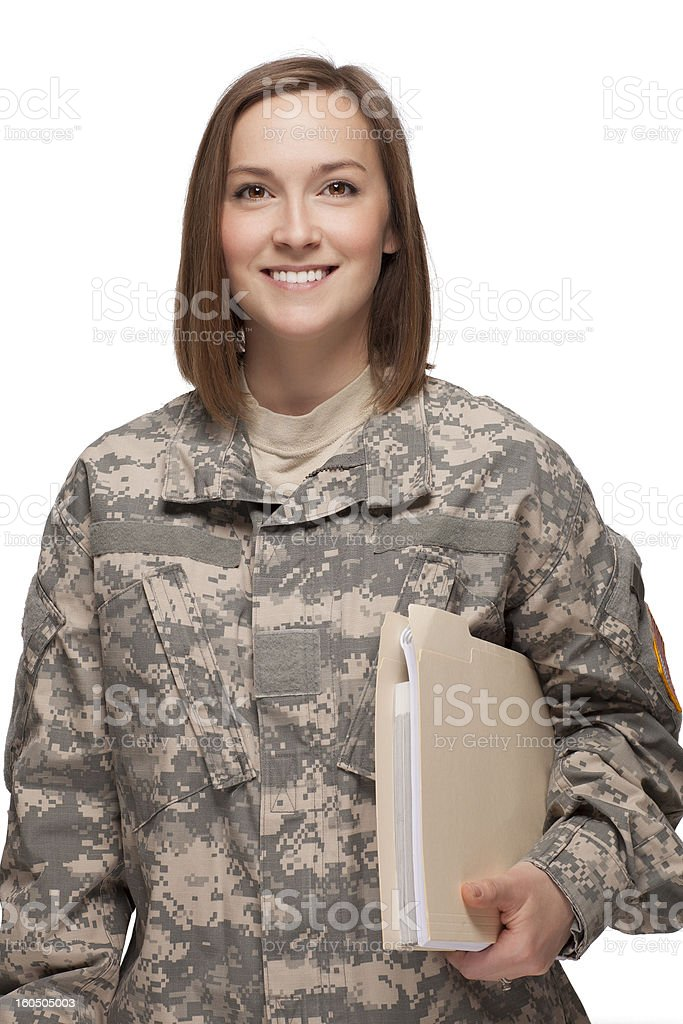 Female Soldier holding books stock photo