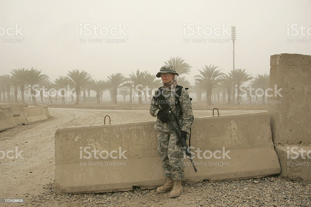 Female Soldier in a Sandstorm stock photo