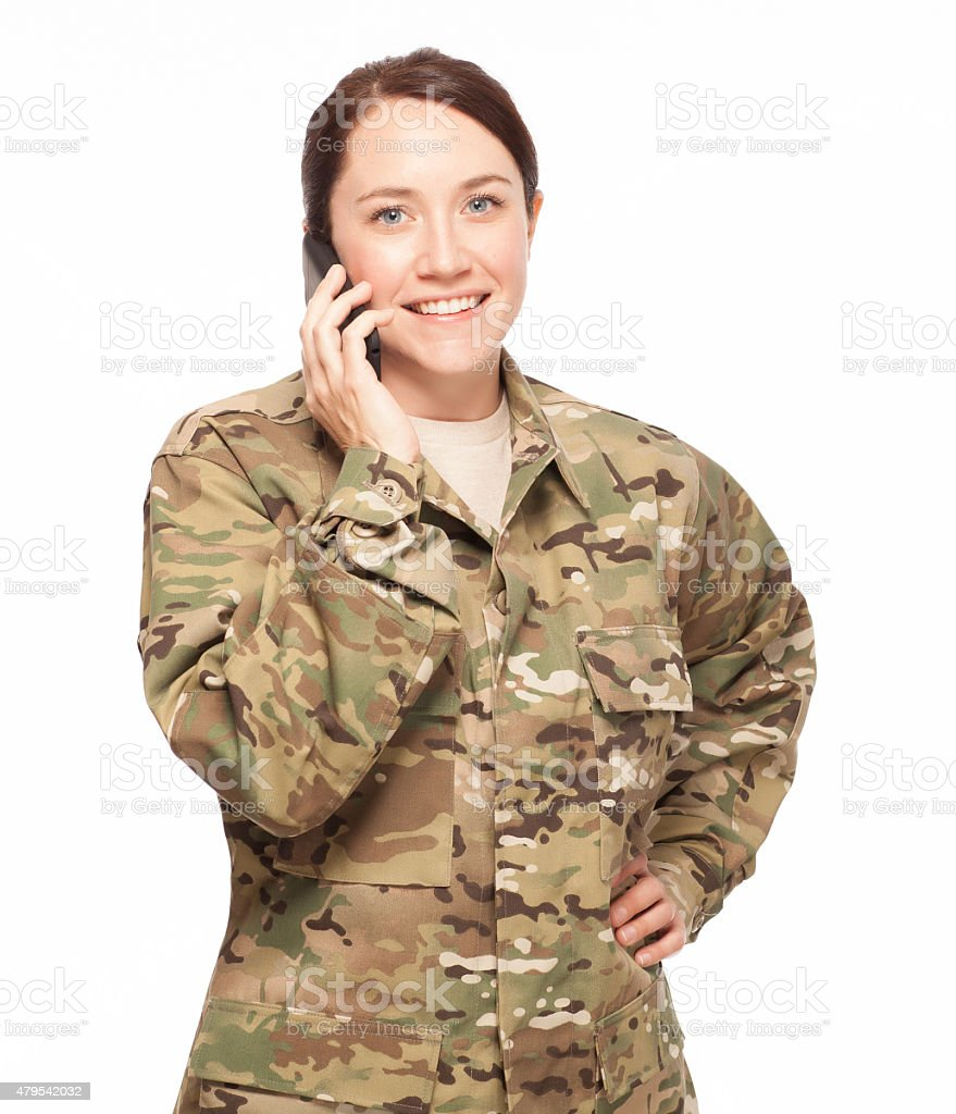 Female soldier on cell phone. stock photo
