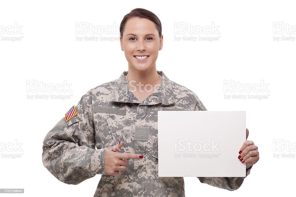 female soldier pointing at a blank placard royalty-free stock photo