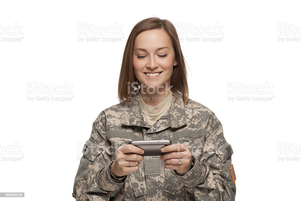 Female Soldier reading text messages royalty-free stock photo