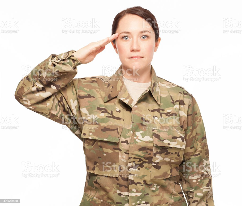 Female soldier saluting. stock photo