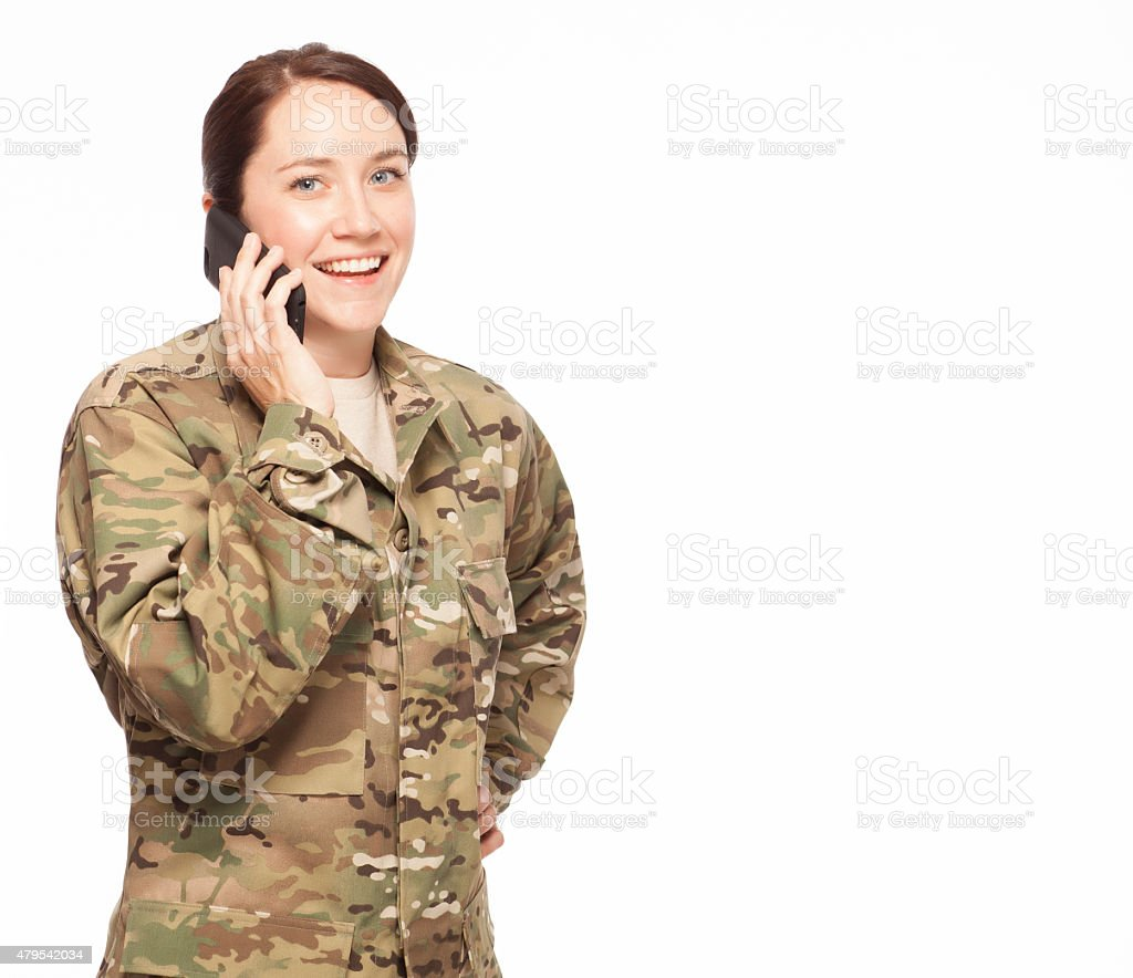 Female soldier talking on the phone. stock photo