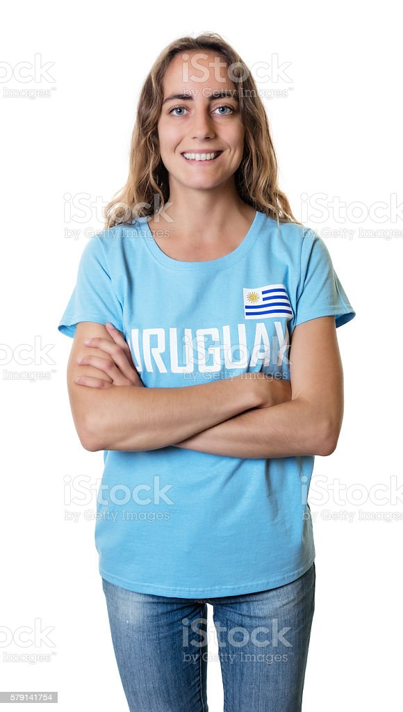 Female sports fan from Uruguay with crossed arms stock photo