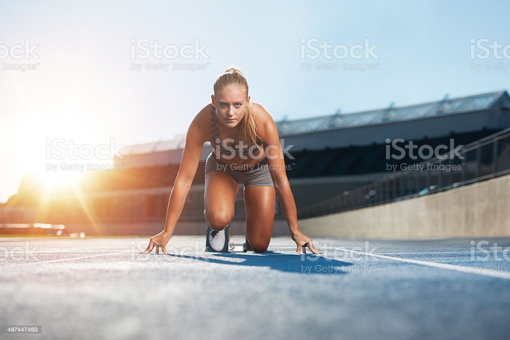 Female sprinter training for race competition stock photo