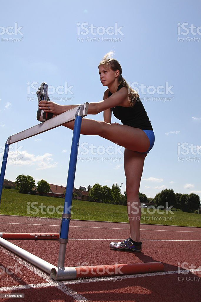Female sprinter warming up royalty-free stock photo