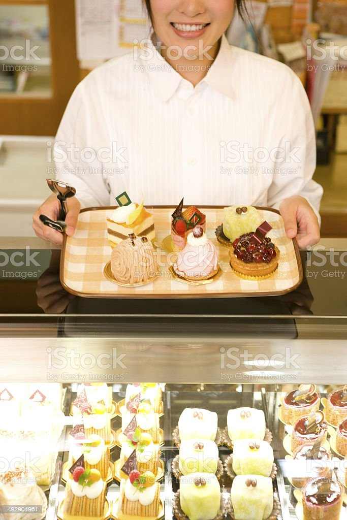 Female staff in cake shop royalty-free stock photo