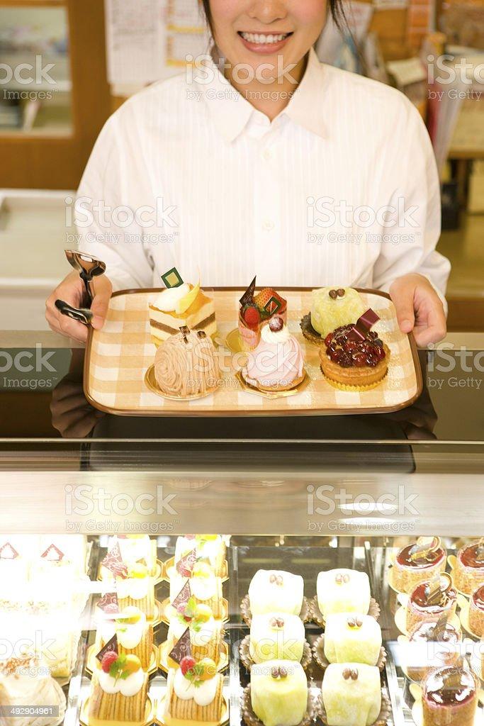 Female staff in cake shop stock photo