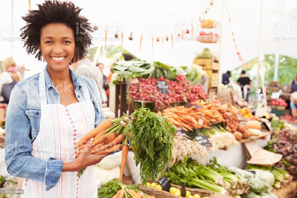 Female Stall Holder At Farmers Fresh Food Market stock photo