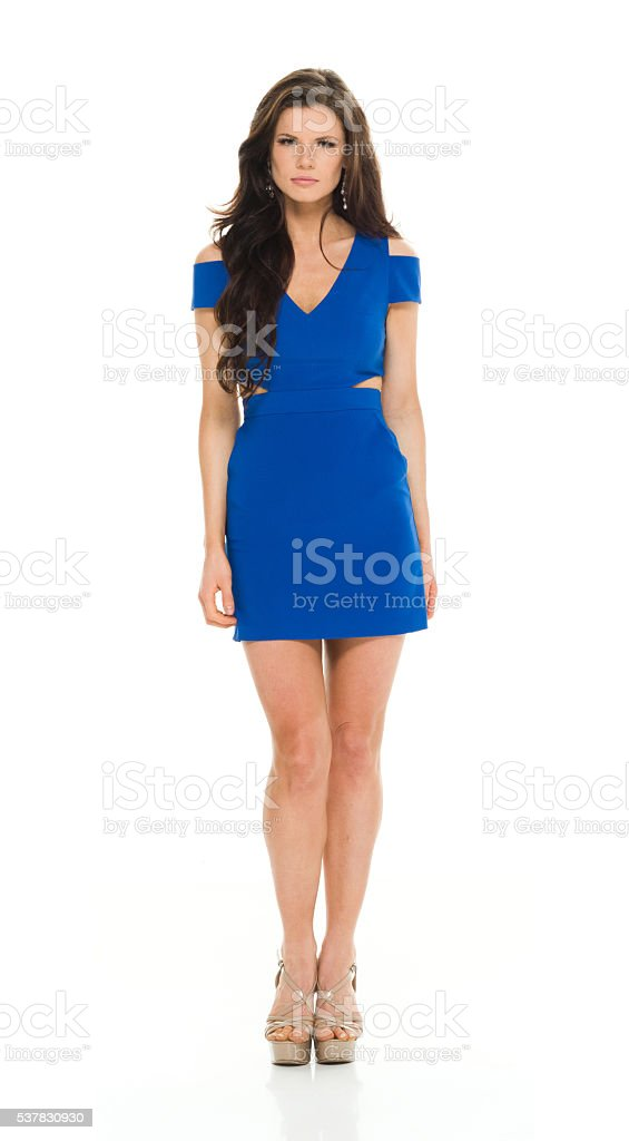 Female standing and looking at camera stock photo